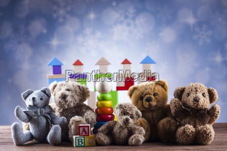 cute, teddy, bears, on, wooden, background - 25336820