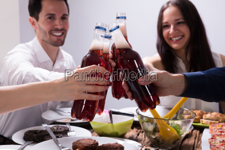 friends, celebrating, with, bottles, of, lemonade - 25336300