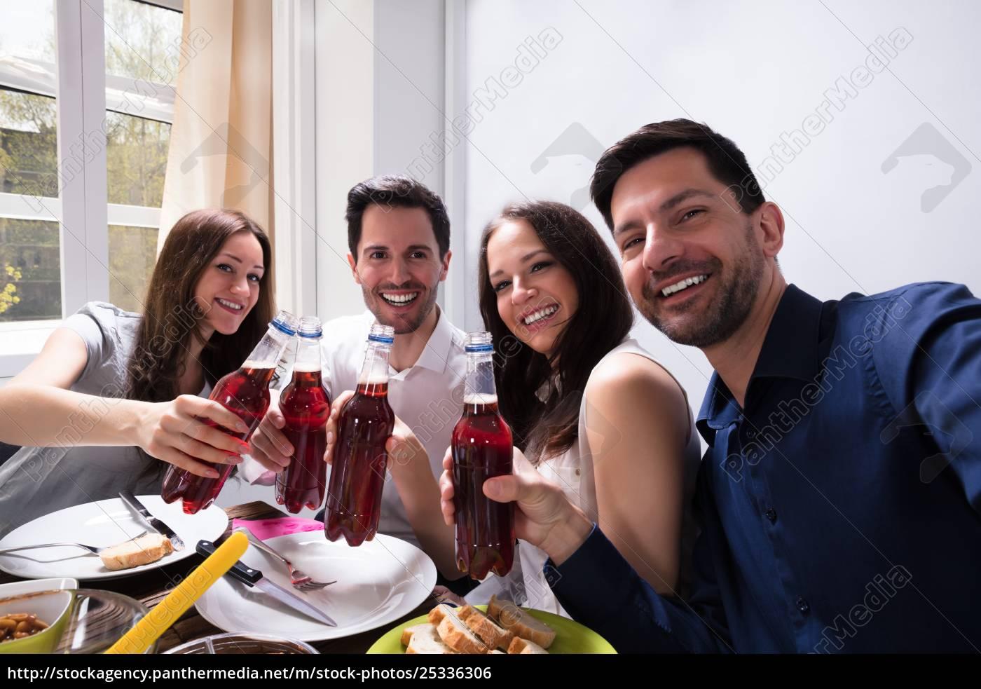 friends, holding, bottle, of, beer - 25336306
