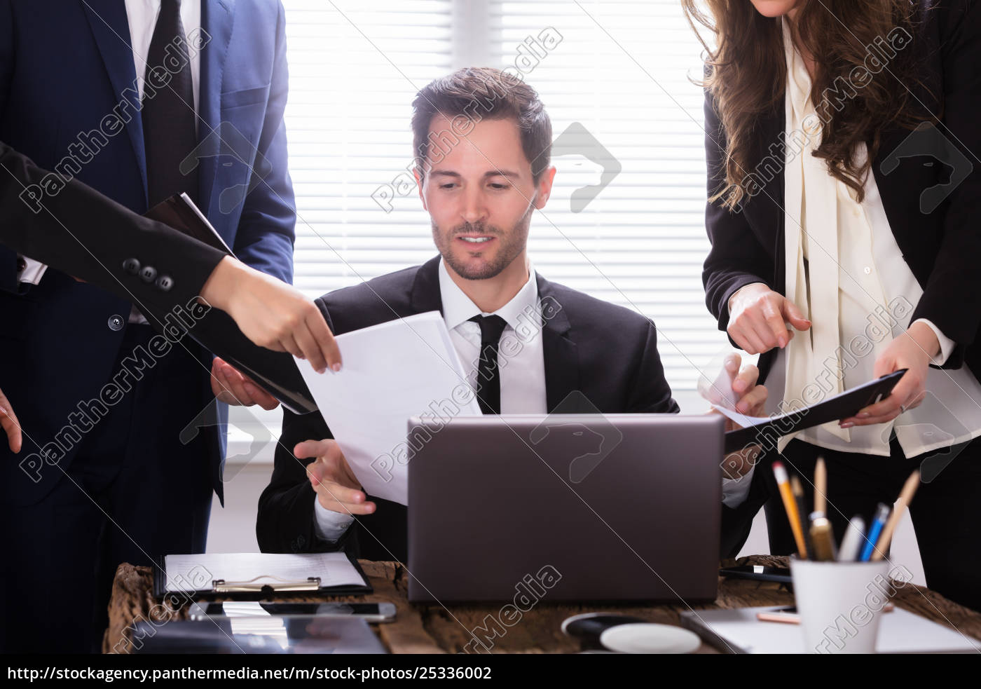 young, businessman, looking, at, document - 25336002