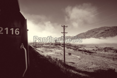train in mountain fields landscape new