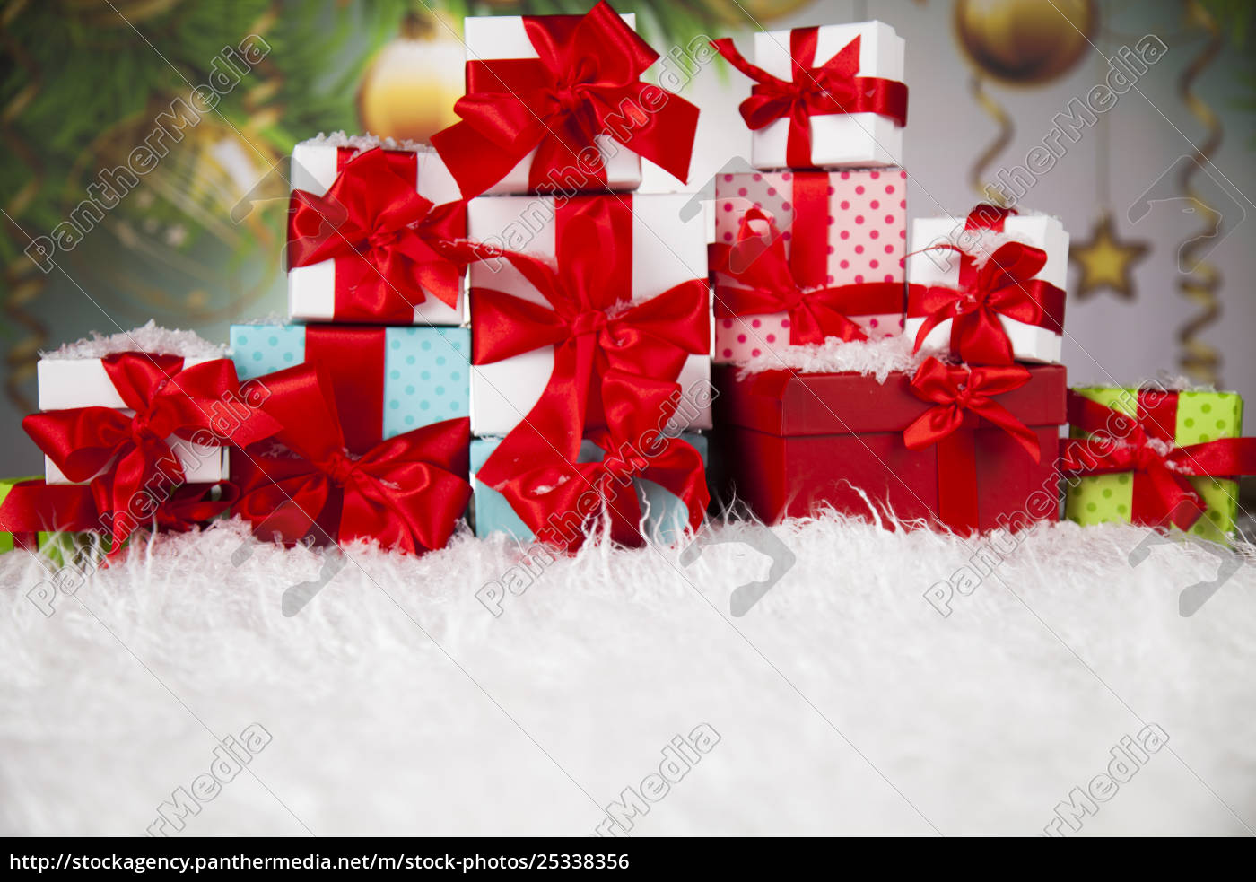 presents, with, red, ribbon, on, wooden - 25338356
