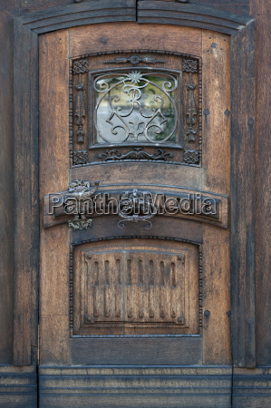 old with carved door and ornate