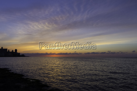 sunset over malecon and atlantic ocean
