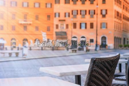 empty restaurant tables in sunlight on
