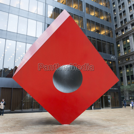 red cube sculpture outside a building