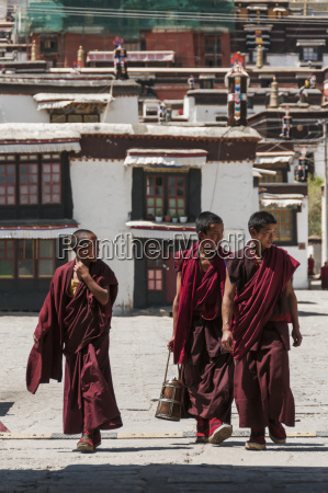 three young monks walking in panchen