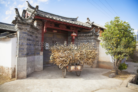 three wheeled chinese bicycle outside traditional