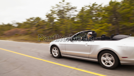 woman driving a mustang convertible massachusetts