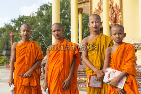 portrait of young monks outside a