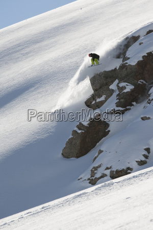 snowboarder on the extreme snowy slopes