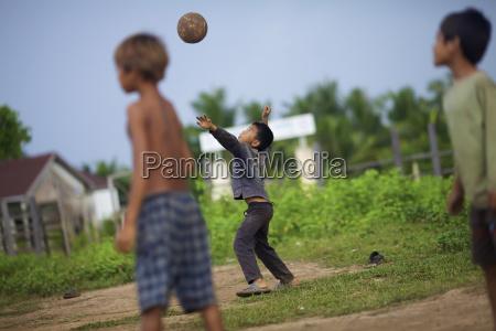 bunong boys playing volleyball mondulkiri cambodia