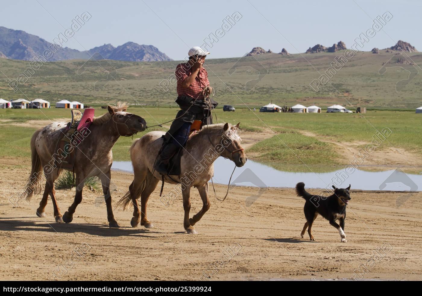 man, on, horseback, talking, on, a - 25399924