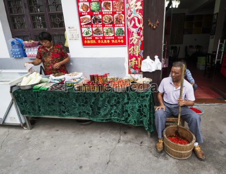 man, crushing, hot, peppers, , hongcun, , anhui, - 25400620