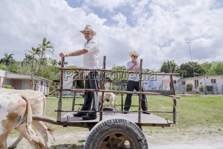 a cuban man and his teenaged