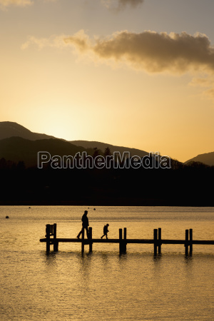 silhouette of a parent and child