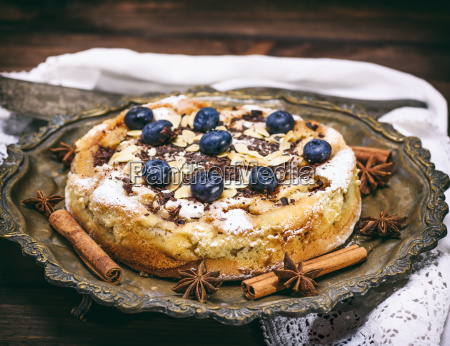 baked round homemade pie with blueberries
