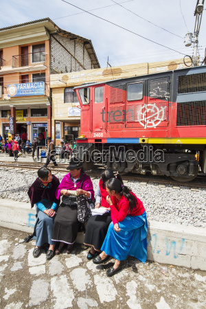 ecuadorian, women, sitting, by, the, railway - 25402002