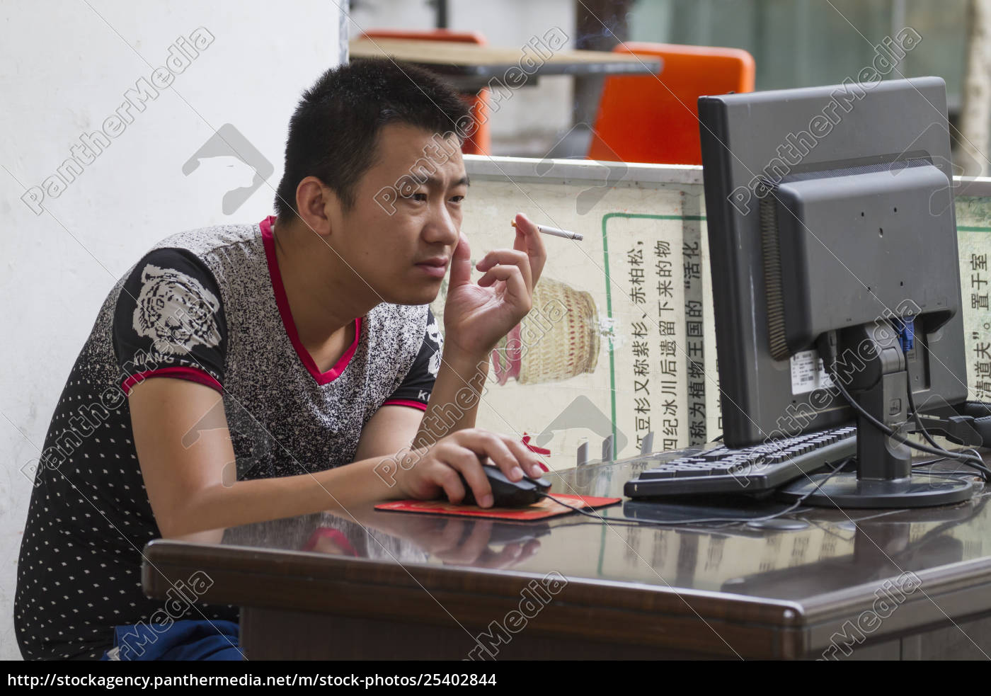 man, smoking, on, a, computer, , hongcun, - 25402844