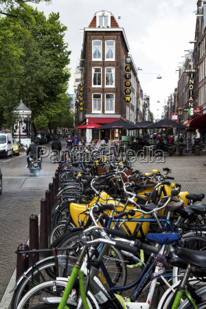 numerous bicycles asked in a row
