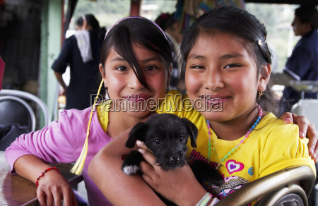 girls holding a puppy cuenca azuay
