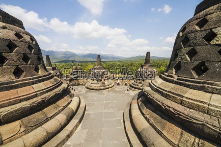 latticed stone stupas containing buddha statues