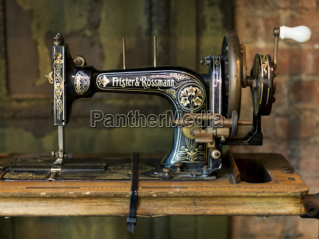 old sewing machine on a wooden