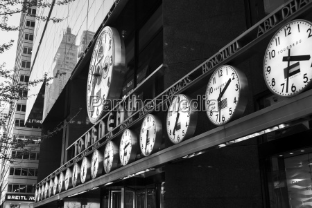 clocks in a row showing times