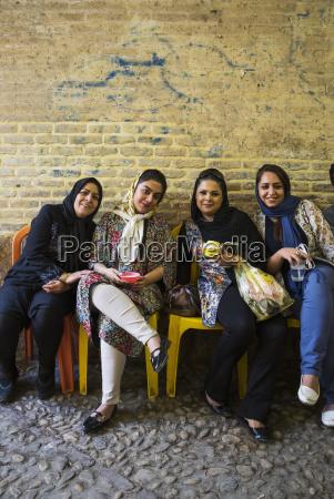 young women enjoying fallodeh frozen dessert