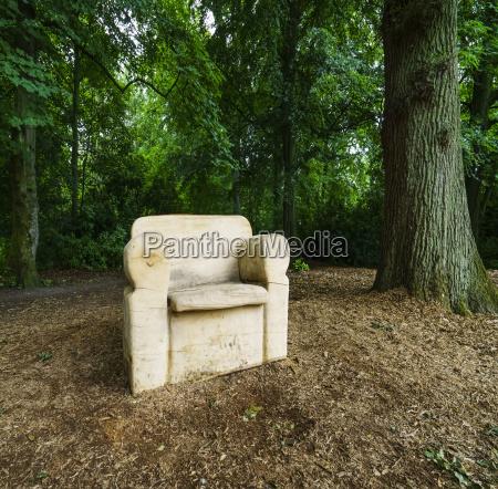 a white armchair sits along a