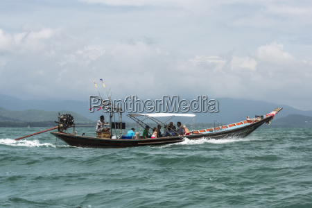 a traditional boat carries passengers across