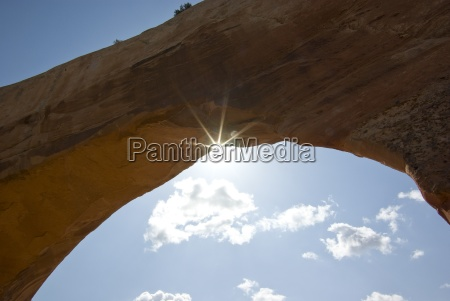 wilson arch utah usa sunlight through