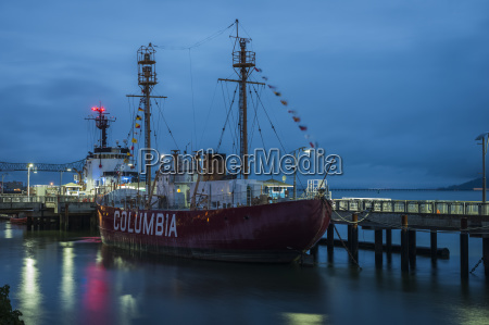 columbia lightship docked along the riverfront