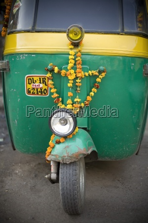 three wheel indian taxi decorated with