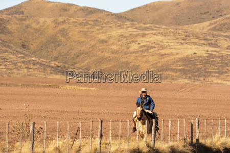 a gaucho is riding his horse