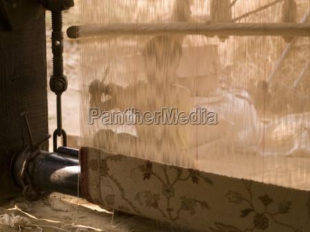 person making a carpet rajasthan india