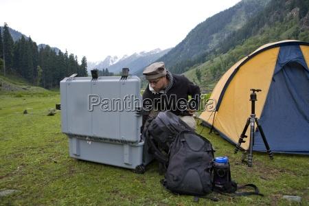 photographer unpacking gear from case lidderwat
