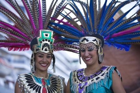 two young women in aztec outfits