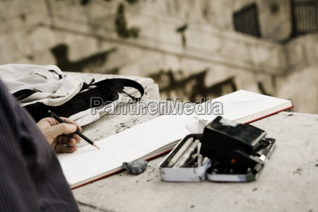 man making sketch outdoors roma italy