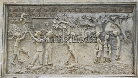 bas relief depicting the atrocities committed