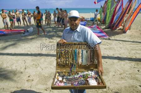 man selling beaded necklaces on the