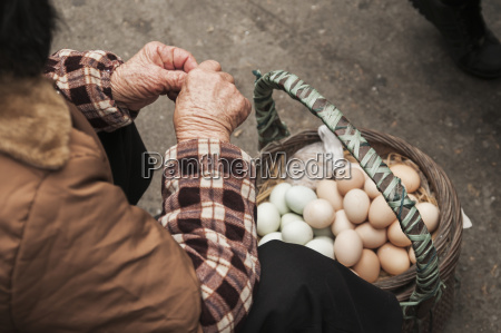 a woman selling chicken eggs in