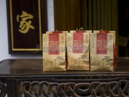 paper bags with asian tea on