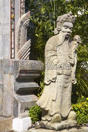 statue outside amarindra winitchai hall at