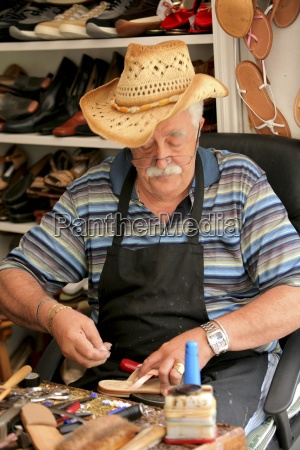 capri italy senior male craftsman making