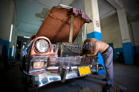 mechanic fixing a car in havana