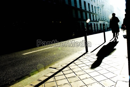 silhouette and shadow of person walking