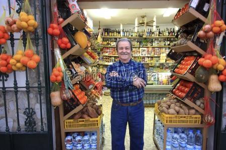 proud shop owner tarifa andalusia spain