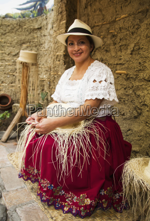 woman weaving a panama hat from