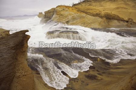 wave crashing on shore oregon coastoregonusa